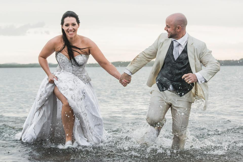 trash the dress, wedding dress, wedding couple in the water, wedding hair and makeup by Sue McLaurin